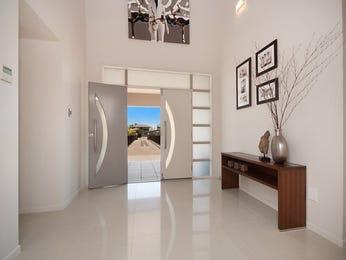 Split-level living room using cream colours with tiles & bi-fold doors - Living Area photo 331317