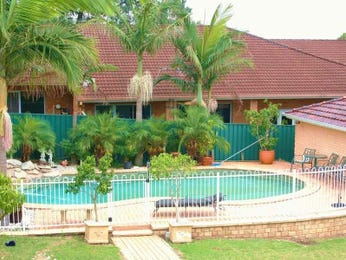 In-ground pool design using brick with pool fence & hedging - Pool photo 536935
