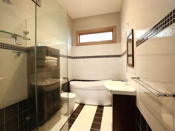 Modern bathroom design with freestanding bath using tiles - Bathroom Photo 1601934