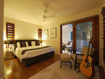Modern bedroom design idea with floorboards & balcony using beige colours - Bedroom photo 398016