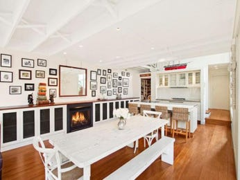 Modern dining room idea with floorboards & fireplace - Dining Room Photo 331890