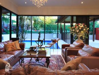 Open plan living room using brown colours with leather & floor-to-ceiling windows - Living Area photo 8206073