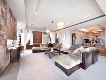 Open plan living room using beige colours with carpet & fireplace - Living Area photo 332034