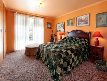 Country bedroom design idea with carpet & built-in wardrobe using orange colours - Bedroom photo 1479948