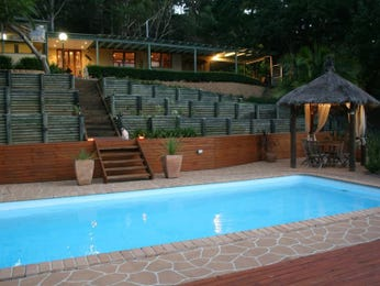 Geometric pool design using bamboo with bbq area & decorative lighting - Pool photo 333249