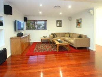 Open plan living room using brown colours with carpet & louvre windows - Living Area photo 364588