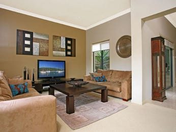 Open plan living room using brown colours with carpet & bay windows - Living Area photo 477132