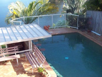 In-ground pool design using brick with glass balustrade & outdoor furniture setting - Pool photo 1450519