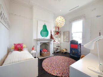 Children's room bedroom design idea with carpet & fireplace using pastel colours - Bedroom photo 1212127