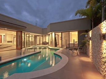 Freeform pool design using natural stone with glass balustrade & decorative lighting - Pool photo 839551