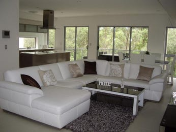 Open plan living room using black colours with carpet & bay windows - Living Area photo 1279264