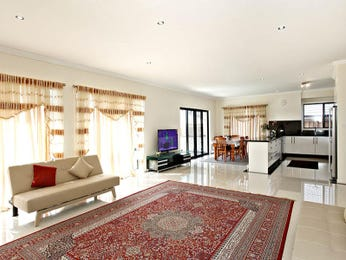 Dining-living living room using beige colours with carpet & floor-to-ceiling windows - Living Area photo 1139933