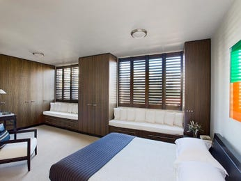 Classic bedroom design idea with wood panelling & window seat using white colours - Bedroom photo 337082