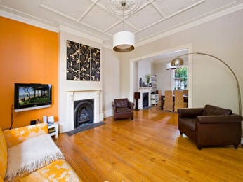 Orange living room idea from a real Australian home - Living Area photo 507093