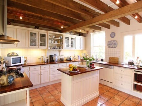 View the country kitchens photo collection on home ideas for Post and beam kitchen ideas