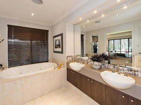 Twin sink near bath; big mirror