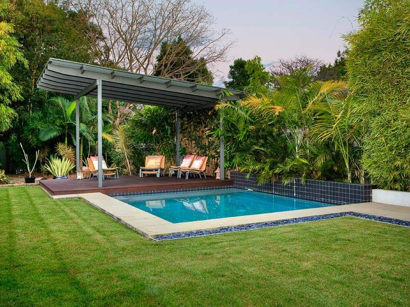 In ground pool design using grass with verandah outdoor for Pool veranda designs