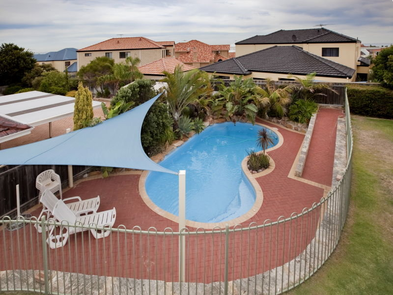 In-ground pool design using brick with pool fence & outdoor furniture setting - Pool photo 373823