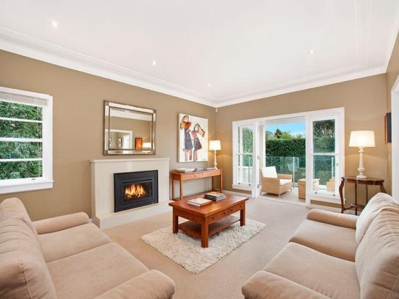 Open Plan Living Room Using Brown Colours With Carpet Fireplace Living Area Photo 139816