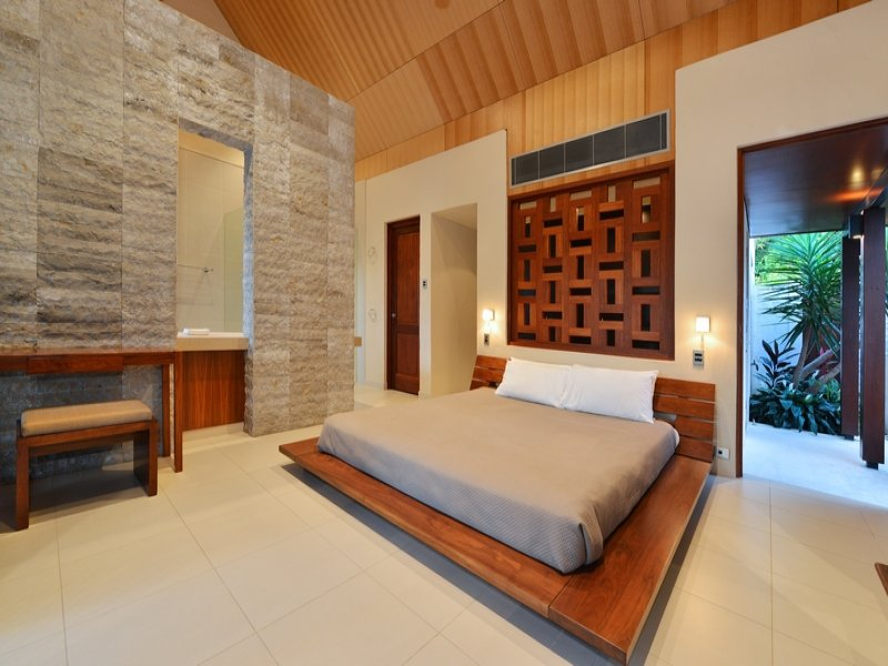 Modern bedroom design idea with wood panelling built in