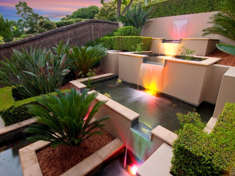 Modern garden design using brick with fish pond for Contemporary pond design