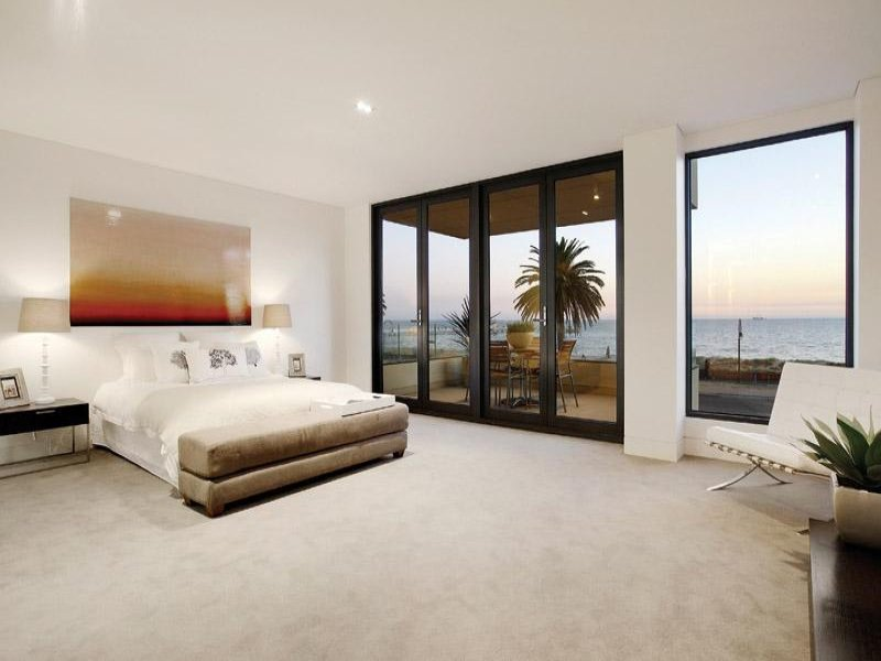 Modern bedroom design idea with carpet & balcony using beige colours - Bedroom photo 389932