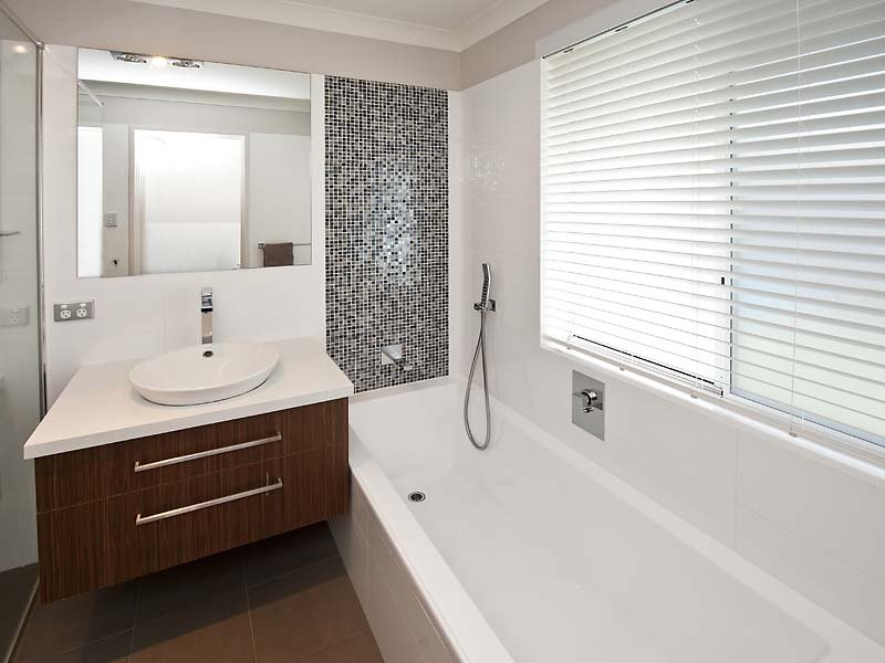Modern bathroom design with spa bath using frameless glass for Main bathroom design ideas