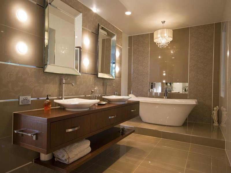 Modern bathroom design with built in shelving using tiles for Latest modern bathroom designs