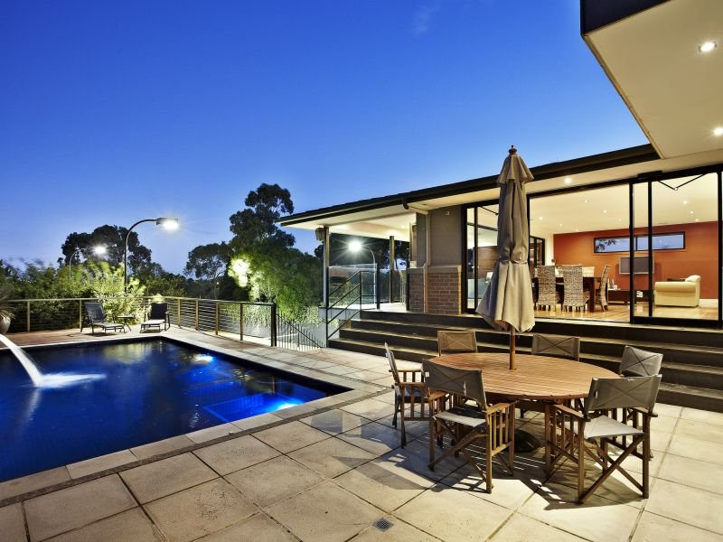 In-ground pool design using stone with decking & decorative lighting - Pool photo 146757