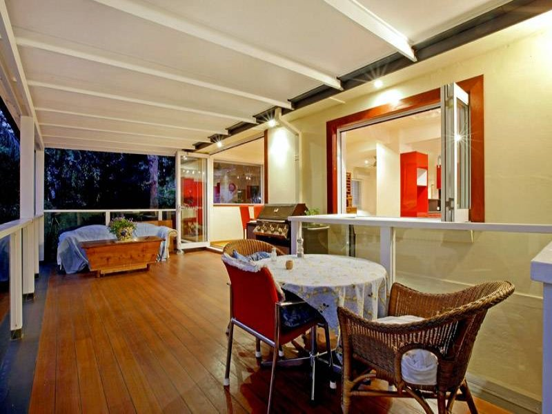 Indoor-outdoor outdoor living design with balcony & decorative lighting using timber - Outdoor Living Photo 391021