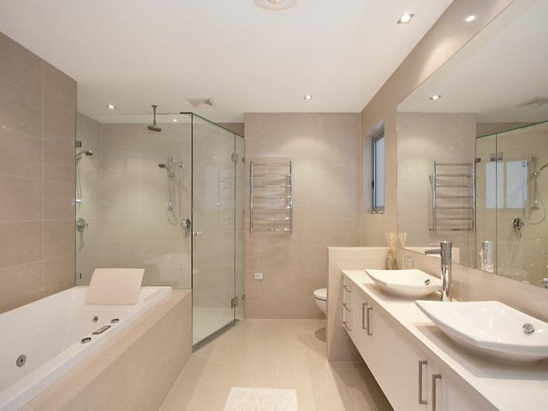 Classic bathroom design with corner bath using exposed for Classic bathroom design