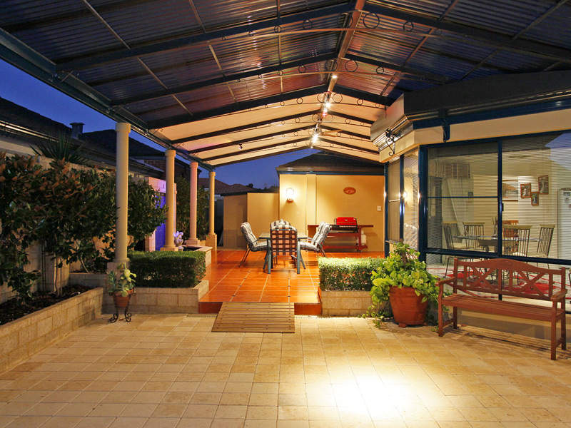 Multi level outdoor living design with bbq area hedging Outdoor living areas images