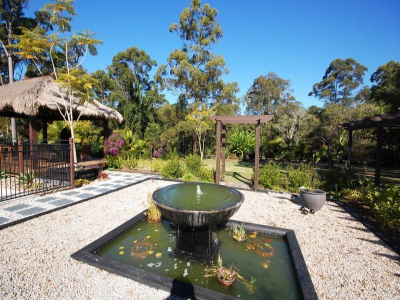 australian native garden design using pebbles with fish pond  u0026 fountain