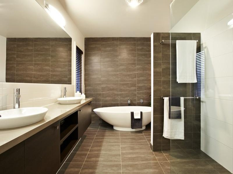 Modern bathroom design with twin basins using tiles for Tiling ideas for bathrooms