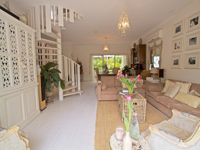 Open plan living room using white colours with floorboards & staircase - Living Area photo 205923