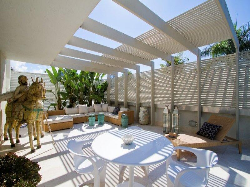 Outdoor living design with pergola from a real australian for Backyard screening ideas