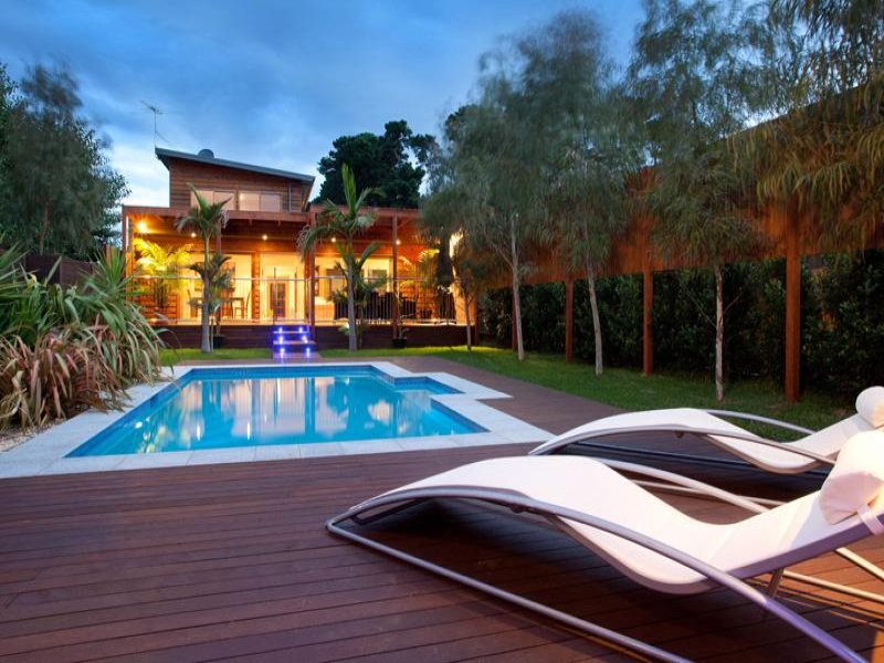 Modern Backyard Pool Designs : Modern pool design using grass with pool fence & ground lighting
