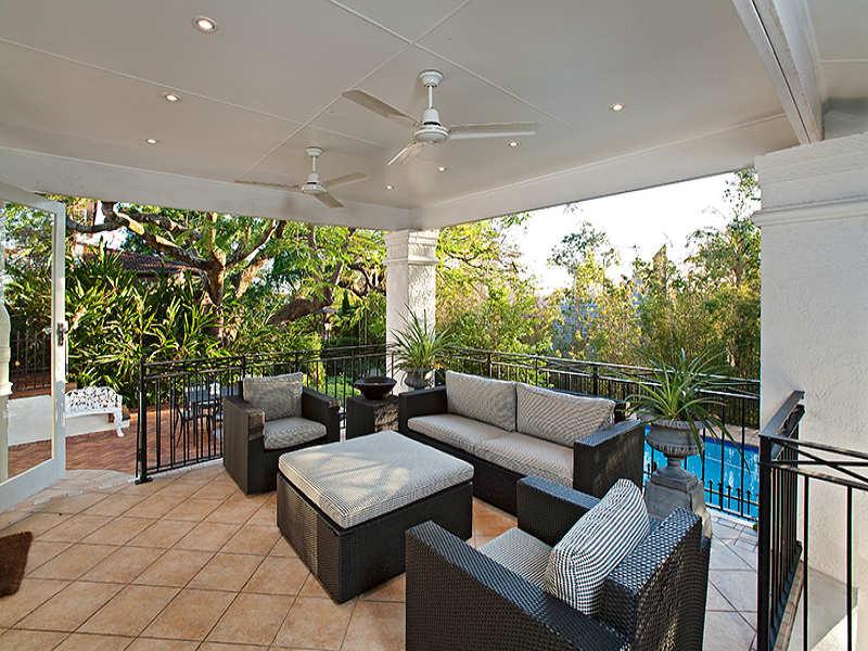Indoor-outdoor outdoor living design with balcony & latticework fence using slate - Outdoor Living Photo 207338