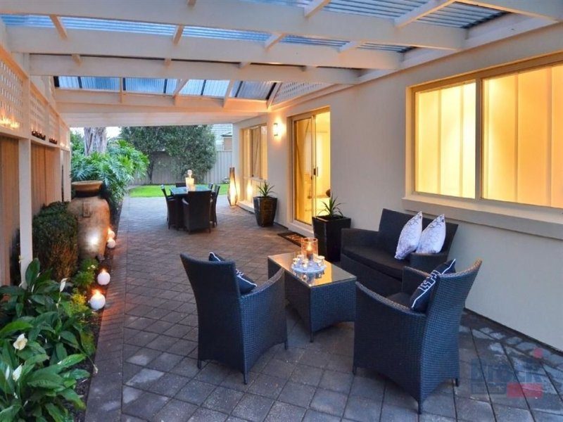 Indoor-outdoor outdoor living design with verandah & decorative lighting using glass - Outdoor Living Photo 209197