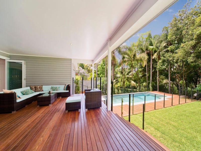 Landscaped pool design using bamboo with bbq area for Pool area designs