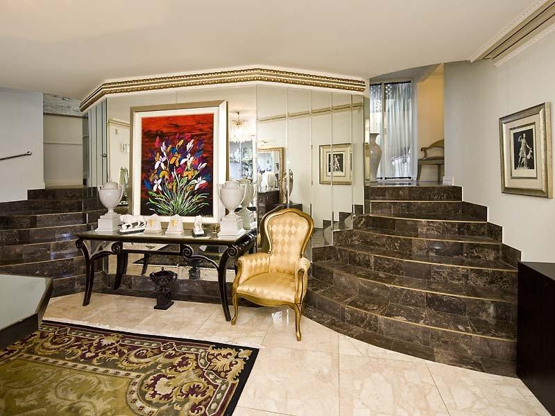 Split level living room using brown colours with tiles for Split level living room design