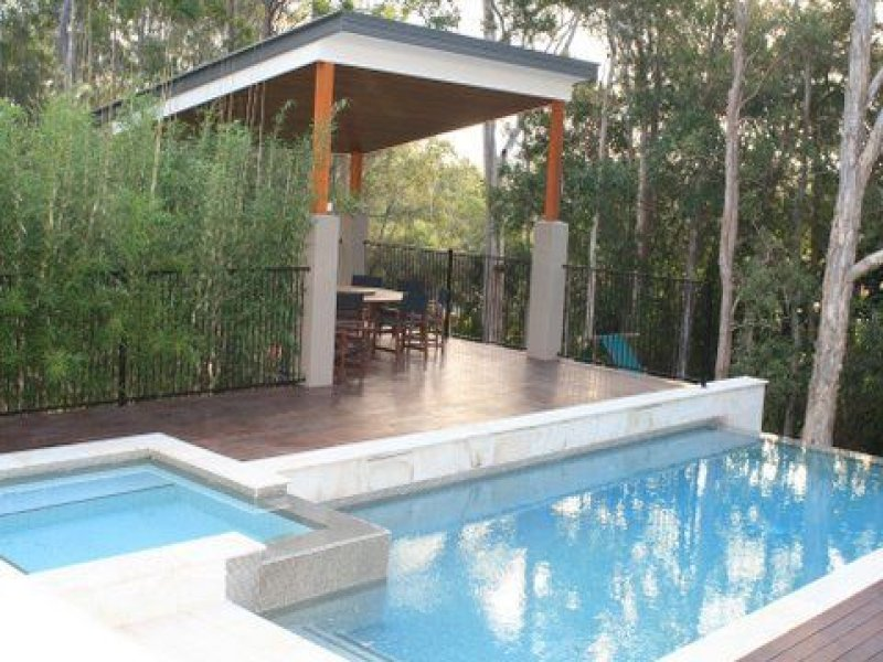 Pool Design Using Timber With Decking & Outdoor Furniture Setting