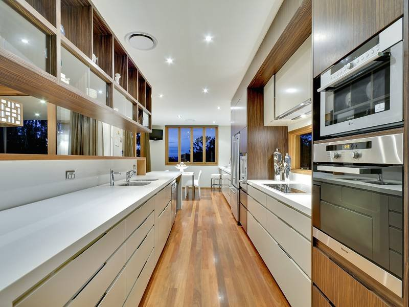 Modern galley kitchen design using floorboards - Kitchen Photo 422192