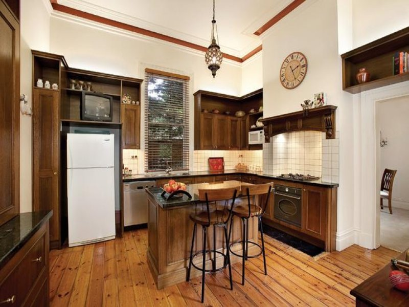 country galley kitchen design using floorboards kitchen
