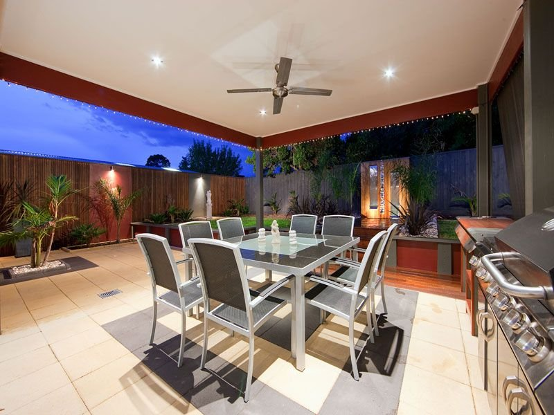 Walled outdoor living design with balcony decorative for Outdoor alfresco designs