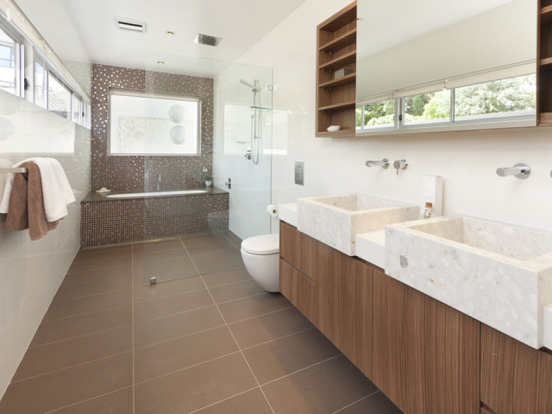 Modern bathroom design with bi fold windows using ceramic for Bathroom ideas with no windows