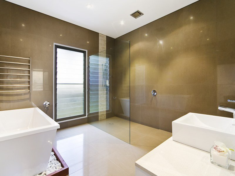 Frameless glass in a bathroom design from an australian for Australian small bathroom design