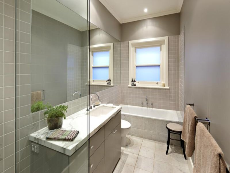 Modern bathroom design with recessed bath using frameless for Small main bathroom ideas