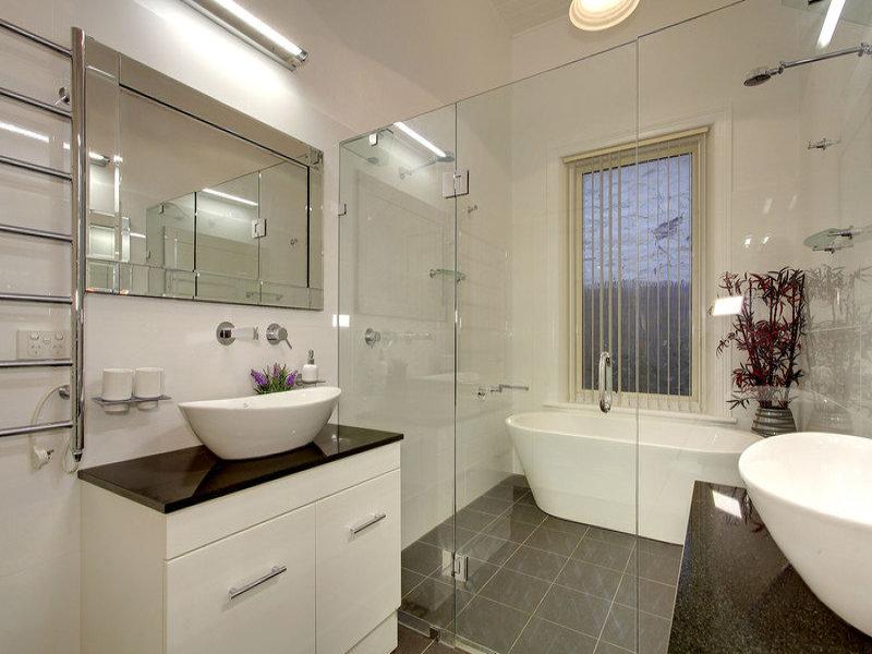Modern bathroom design with freestanding bath using chrome for Main bathroom design ideas