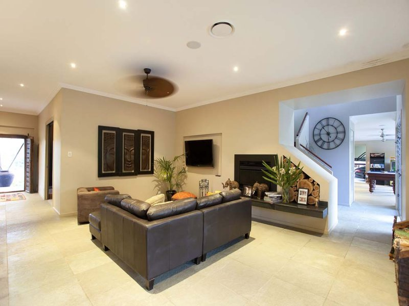Open Plan Living Room Using Beige Colours With Carpet Fireplace Living Area Photo 1108466